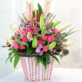 Pink & Purple bouquet in container, Pink & Purple bouquet in container