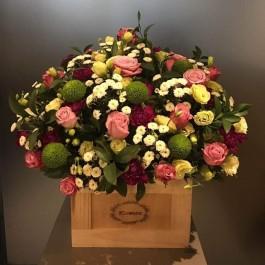 Seasonal flowers in wooden vase, Seasonal flowers in wooden vase